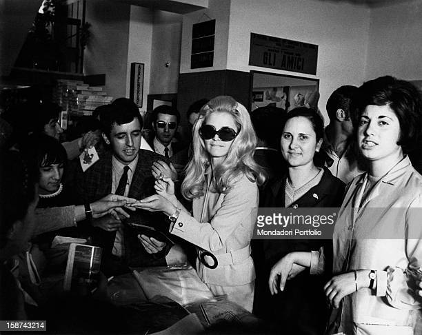 Italian singer Patty Pravo signing autographs for her fans Rome May 1968