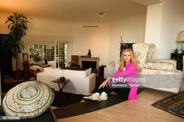 Italian singer Patty Pravo sitting in her house in Rome Rome 1990s