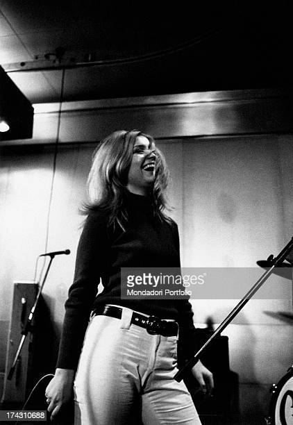 Italian singer Patty Pravo smiling during a concert 1966