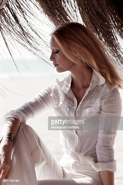 Italian singer Patty Pravo wearing a shirt and a pair of white trousers Italy 1974