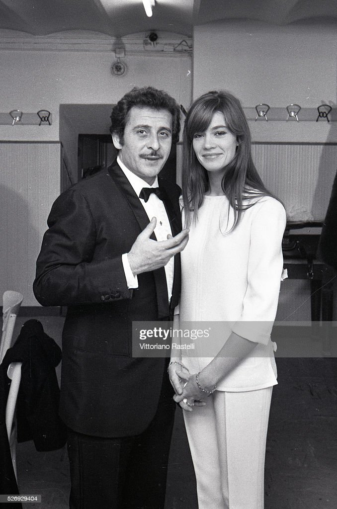 Italian singer songwriter and actor Domenico Modugno and French singer songwriter and actress Francoise Hardy attend the Sanremo Music Festival