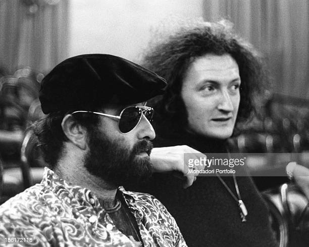 Italian singer songwriter and musician Lucio Dalla and Italian singer Maurizio Vandelli relaxing while waiting to perform at the 7th Pop Music...
