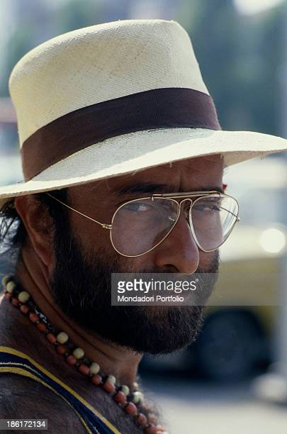 Italian singer songwriter and musician Lucio Dalla posing with a straw hat on the head 1980