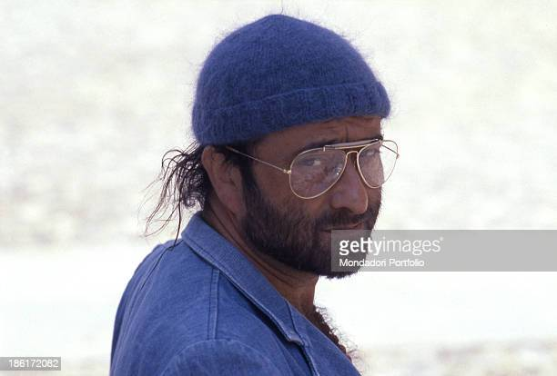 Italian singer songwriter and musician Lucio Dalla posing with a beret on his head 1985