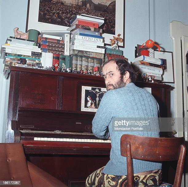 Italian singer songwriter and musician Lucio Dalla sitting at the piano 1967