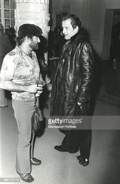 Italian singer songwriter and musician Lucio Dalla talking to Italian singer songwriter and actor Domenico Modugno at 22nd Sanremo Music Festival...