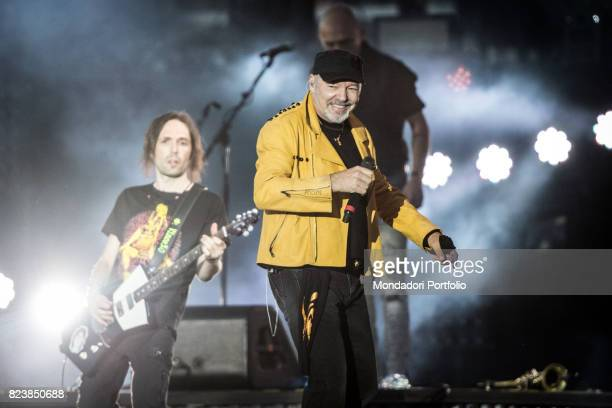 Italian singer Vasco Rossi abd guitarist Vince Pastano performs during the record concert at Enzo Ferrari Park where 220000 people attends Modenda...