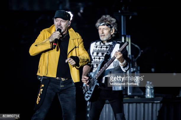Italian singer Vasco Rossi and bassist Claudio Golinelli performs during the record concert at Enzo Ferrari Park where 220000 people attends Modenda...