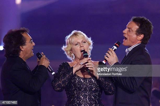 Italian singers Al Bano Katia Ricciarelli and Massimo Ranieri singing at the TV show dedicated to the Apulian singer 'Una voce nel sole' broadcasted...