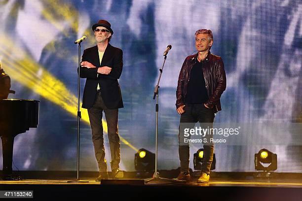 Italian singers Francesco De Gregori and Luciano Ligabue perform the 'Viva il 25 aprile' at Piazza del Quirinale on April 25 2015 in Rome Italy