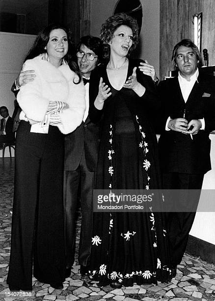 Italian singers Gigliola Cinquetti Nicola Di Bari and Iva Zanicchi and Italian musician Gianfranco Intra posing for a portrait Venice 1970s