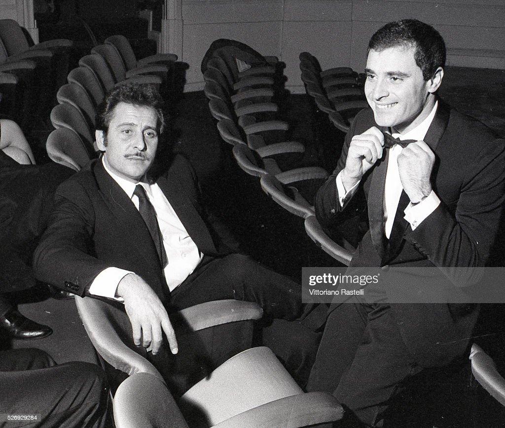 Italian singers songwriters and actors Domenico Modugno and Edoardo Vianello attend the Sanremo Music Festival