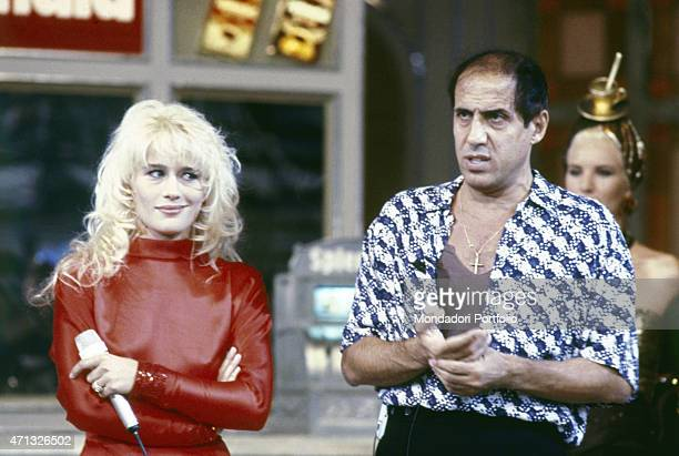 Italian singersongwriter actor dancer and showman Adriano Celentano and American dancer singer and showgirl Heather Parisi presenting an episode of...