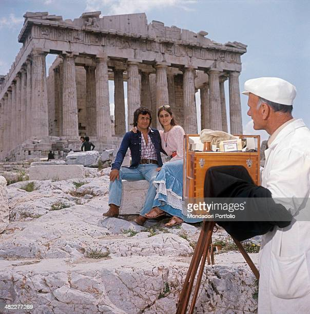 Italian singersongwriter Al Bano and American singer and actress Romina Power posing for a photograph in front of the Parthenon Athens 1970s