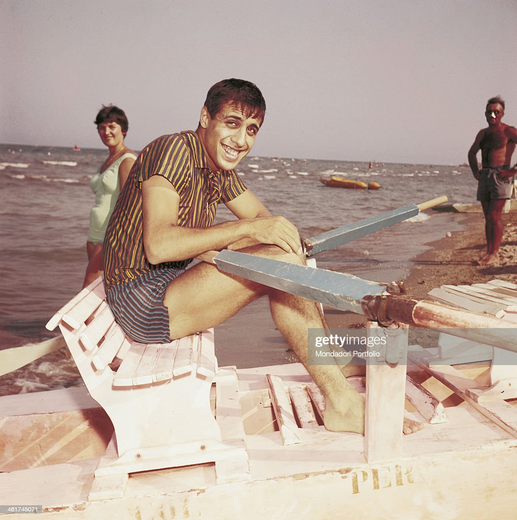 Italian singersongwriter and actor Adriano Celentano sitting amused on a pedalo Italy 1962