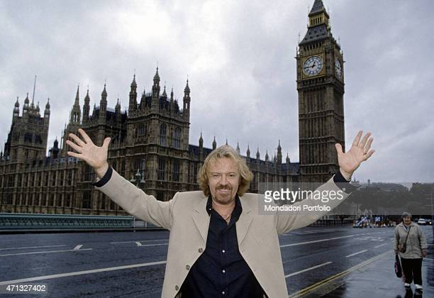 Italian singersongwriter and guitarist Umberto Tozzi posing in front of the Palace of Westminster nearby the clock tower housing the Big Ben London...