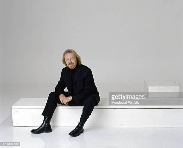 Italian singersongwriter and guitarist Umberto Tozzi posing smiling Italy 1997
