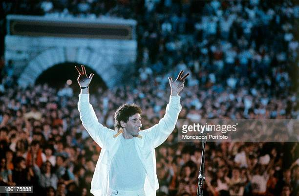 Italian singersongwriter and musician Franco Battiato greeting the public during a concert at Verona Arena Verona 1980s