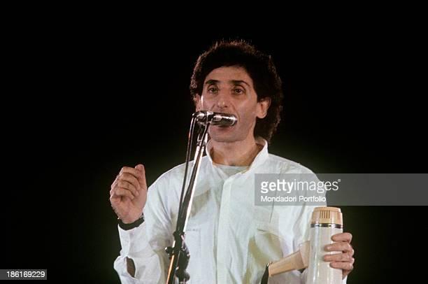 Italian singersongwriter and musician Franco Battiato performing in a concert at Verona Arena Verona 1980s
