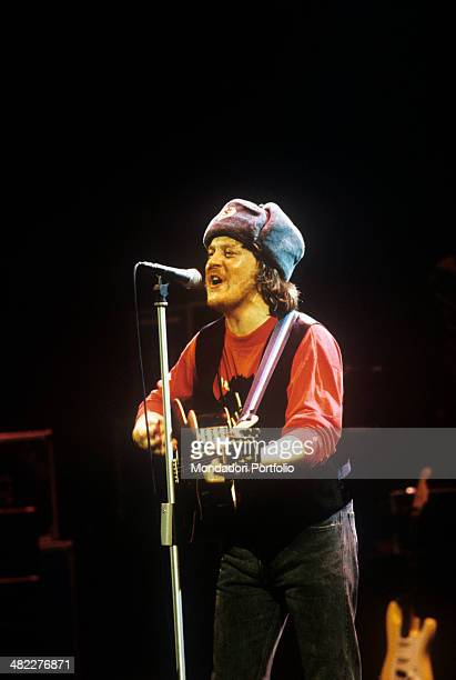 Italian singersongwriter and musician Zucchero singing at State Kremlin Palace wearing a shapka decorated with hammer and sickle Moscow December 1990