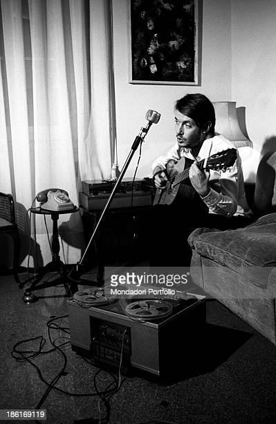 Italian singersongwriter Fabrizio De André playing the guitar Genoa December 1969