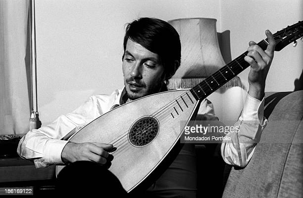 Italian singersongwriter Fabrizio De André playing the lute Genoa December 1969