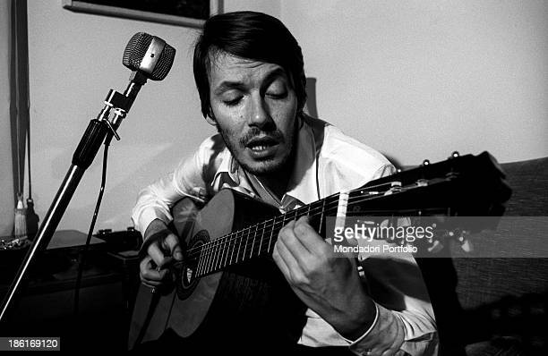 Italian singersongwriter Fabrizio De André singing and playing the guitar Genoa December 1969