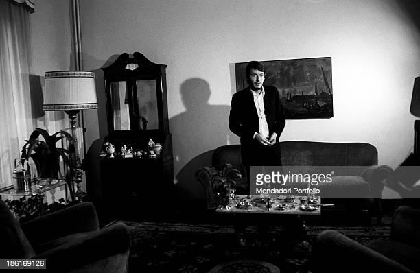 Italian singersongwriter Fabrizio De André standing in a living room Genoa December 1969