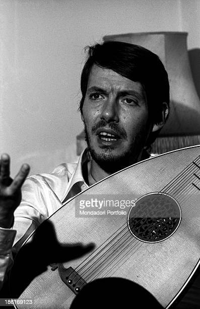 Italian singersongwriter Fabrizio De André talking with a lute in his hands Genoa December 1969