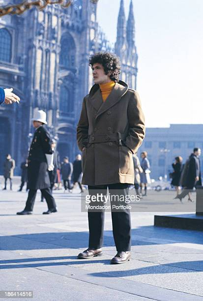 Italian singersongwriter Lucio Battisti stopping in piazza Duomo in Milan Milan 1970
