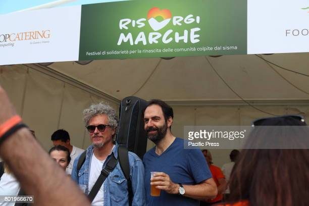 Italian singersongwriter Niccolò Fabi with Neri Marcorè Italian singersongwriter Niccolò Fabi in concert accompanied by the music group 'Gnu Quartet'...