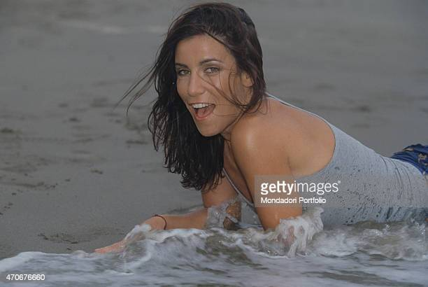 Italian singersongwriter Paola Turci posing lying by the sea 2000