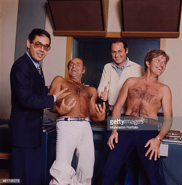 Italian singersongwriter radio and TV host Renzo Arbore and Italian radio and TV author and host Gianni Boncompagni having fun while pointing at...