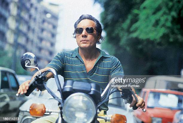 Italian singersongwriter standup comedian and actor Enzo Jannacci driving a motorbike 1985