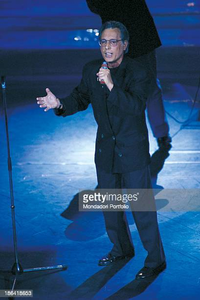 Italian singersongwriter standup comedian and actor Enzo Jannacci performing on stage 1990s