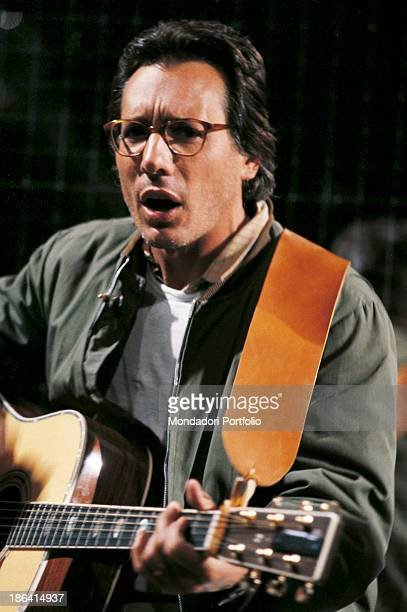 Italian singersongwriter standup comedian and actor Enzo Jannacci singing and playing guitar 1980
