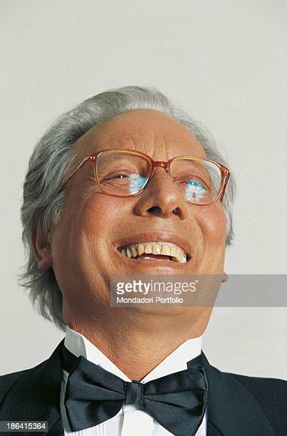 Italian singersongwriter standup comedian and actor Enzo Jannacci laughing 1990s