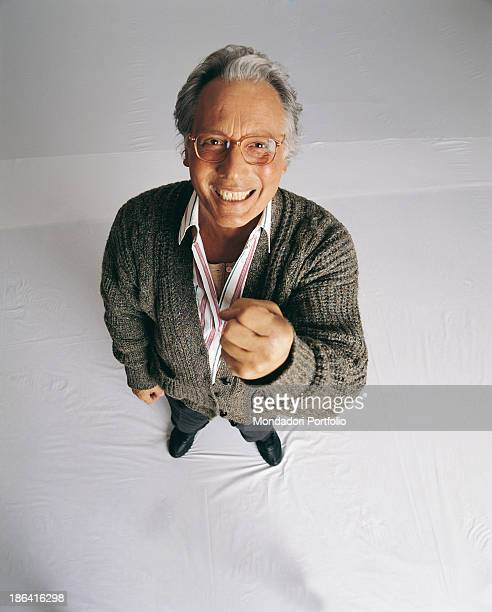 Italian singersongwriter standup comedian and actor Enzo Jannacci smiling and raising his fist The singersongwriter takes part in the 48th Sanremo...