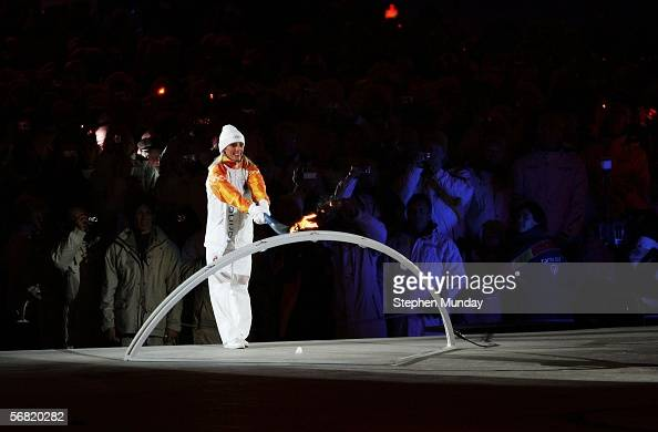 Italian skier Stefania Belmondo lits the Olympic flame during the Opening Ceremony of the Turin 2006 Winter Olympic Games on February 10 2006 at the...