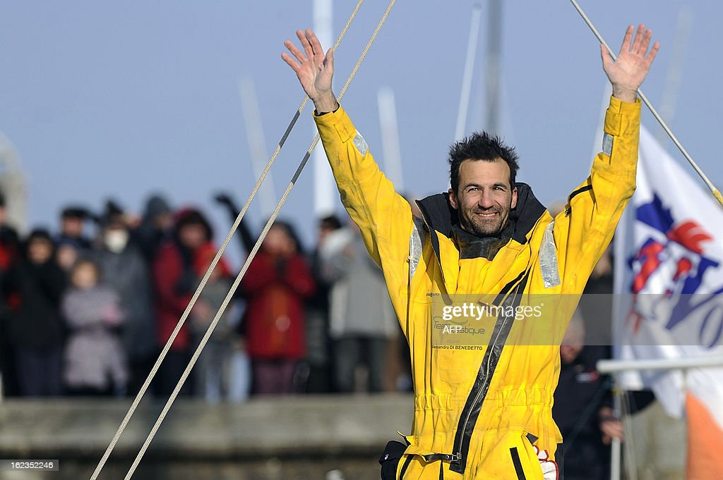 Italian skipper Alessandro di Benedetto, applauded by fans, celebrates on his monohull 'Team plastique' upon his arrival in Les Sables d'Olonne, western France, after crossing the finish line of the 7th Vendee Globe round-the-world solo race on February 22, 2013. Benedetto took the eleventh and last place.