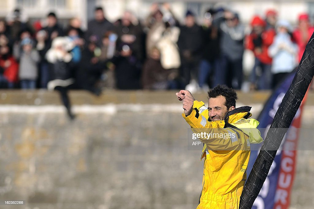 Italian skipper Alessandro di Benedetto, applauded by fans, celebrates on his monohull 'Team plastique' upon his arrival in Les Sables d'Olonne, western France, after crossing the finish line of the 7th Vendee Globe round-the-world solo race on February 22, 2013. Benedetto took the eleventh and last place. AFP PHOTO / JEAN-SEBASTIEN EVRARD