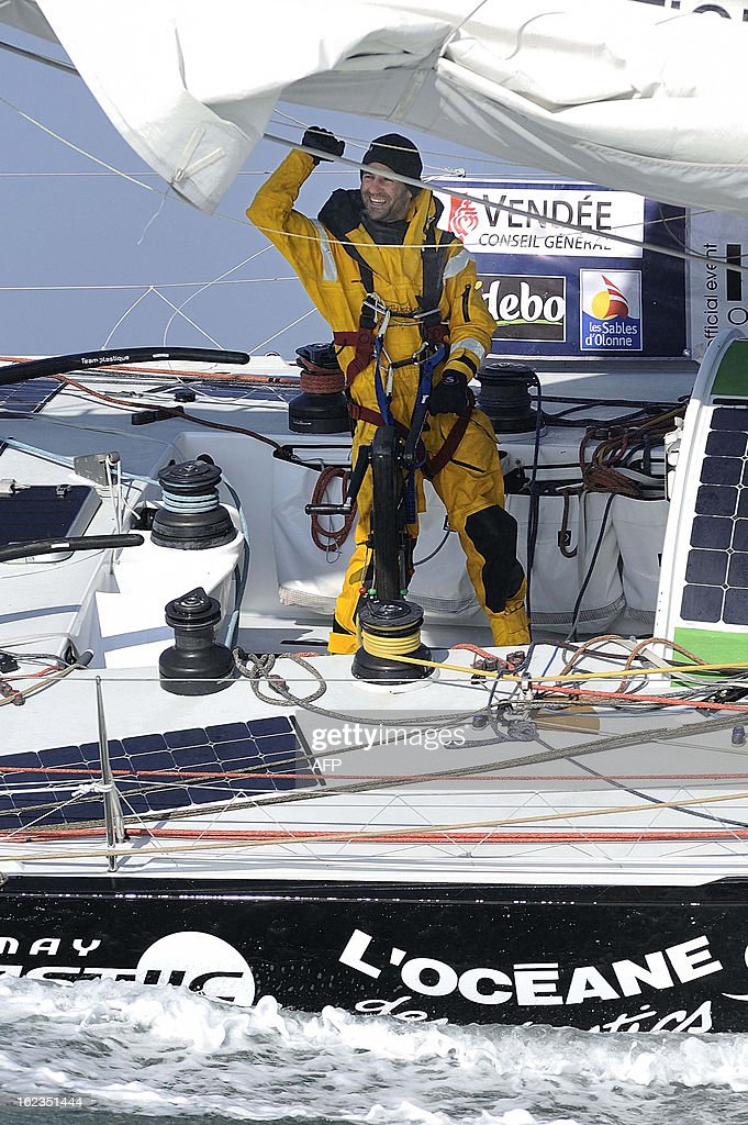 Italian skipper Alessandro di Benedetto celebrates on his monohull 'Team plastique' after crossing the finish line of the 7th Vendee Globe round-the-world solo race on February 22, 2013 off Les Sables d'Olonne, western France. Benedetto took the eleventh and last place. AFP PHOTO / JEAN-SEBASTIEN EVRARD