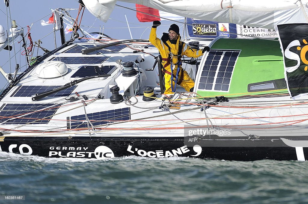 Italian skipper Alessandro di Benedetto celebrates on his monohull 'Team plastique' after crossing the finish line of the 7th Vendee Globe round-the-world solo race on February 22, 2013 off Les Sables d'Olonne, western France. Benedetto took the eleventh and last place.