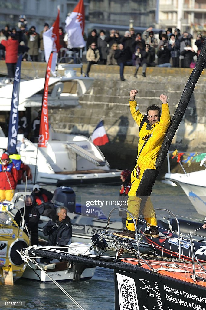Italian skipper Alessandro di Benedetto celebrates on his monohull 'Team plastique' after crossing the finish line of the 7th Vendee Globe round-the-world solo race on February 22, 2013 in Les Sables d'Olonne, western France. Benedetto took the eleventh and last place. AFP PHOTO / JEAN-SEBASTIEN EVRARD