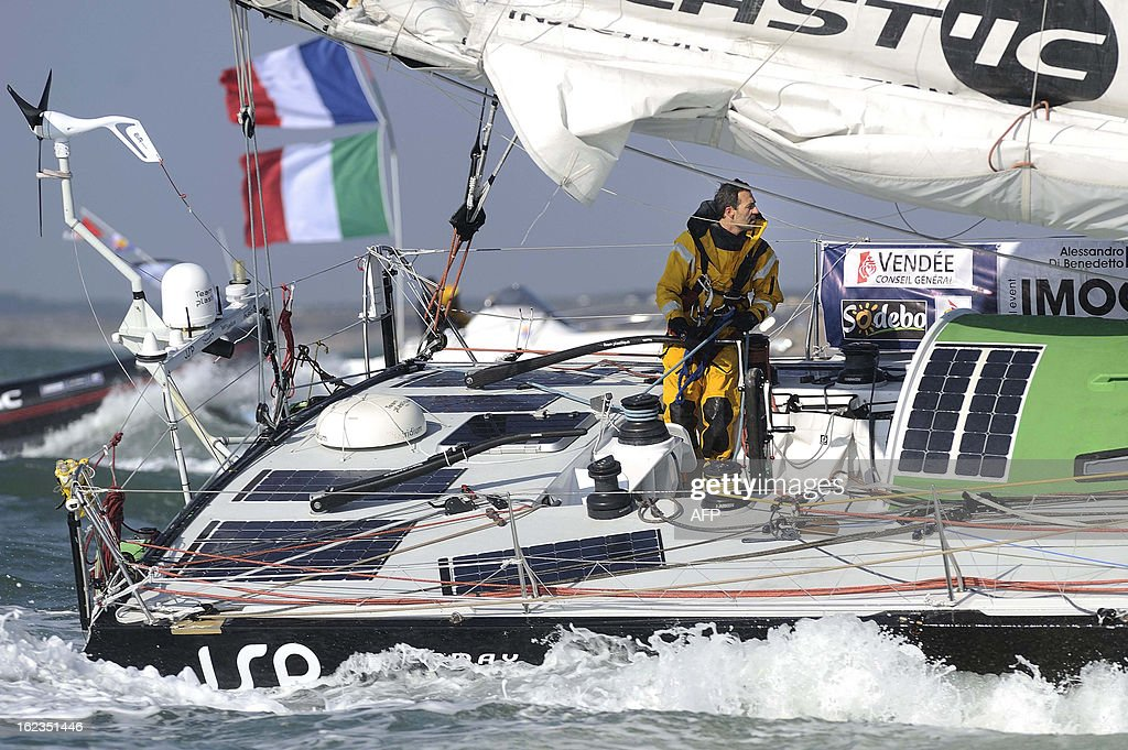 Italian skipper Alessandro di Benedetto on his monohull 'Team plastique' crosses the finish line of the 7th Vendee Globe round-the-world solo race on February 22, 2013 off Les Sables d'Olonne, western France. Benedetto took the eleventh and last place. AFP PHOTO / JEAN-SEBASTIEN EVRARD