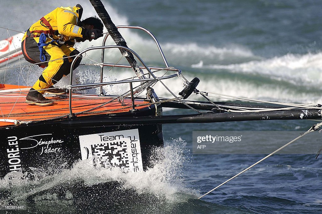 Italian skipper Alessandro di Benedetto reacts on his monohull 'Team plastique' after crossing the finish line of the 7th Vendee Globe round-the-world solo race on February 22, 2013 off Les Sables d'Olonne, western France. Benedetto took the eleventh and last place. AFP PHOTO / JEAN-SEBASTIEN EVRARD