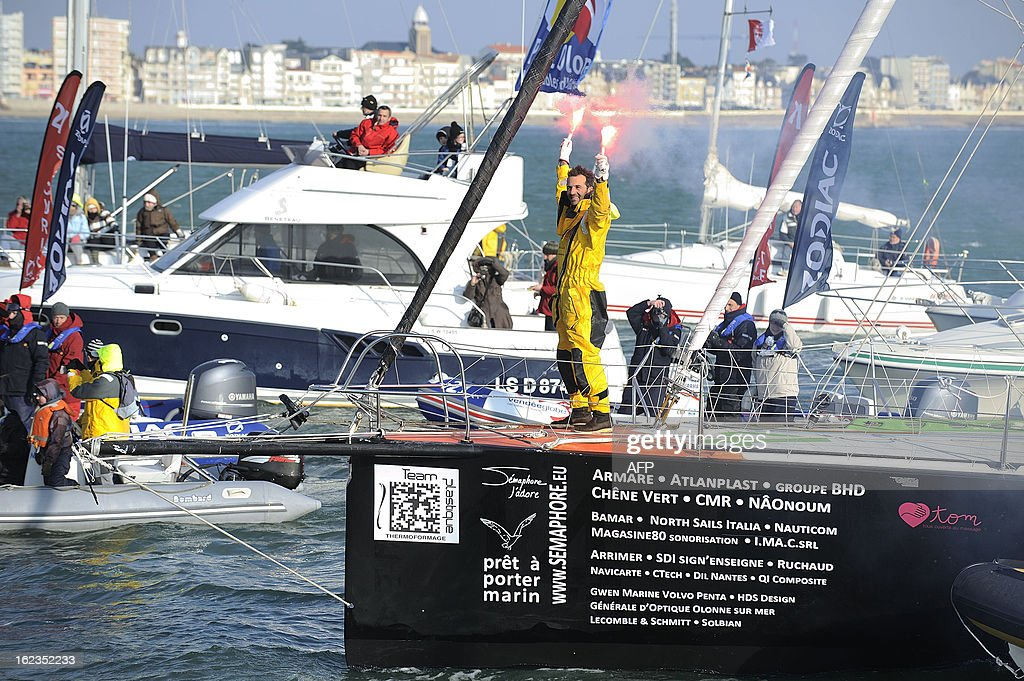 Italian skipper Alessandro di Benedetto, surrounded by fans, celebrates on his monohull 'Team plastique' upon his arrival in Les Sables d'Olonne, western France, after crossing the finish line of the 7th Vendee Globe round-the-world solo race on February 22, 2013. Benedetto took the eleventh and last place. AFP PHOTO / JEAN-SEBASTIEN EVRARD