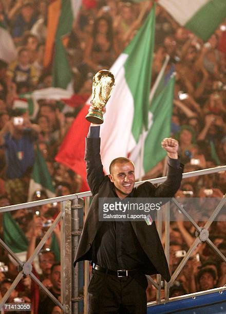 Italian soccer fans celebrate as the teams captain Fabio Cannavaro displays the FIFA World Cup Trophy at the Circo Massimo on July 10 2006 in Rome...