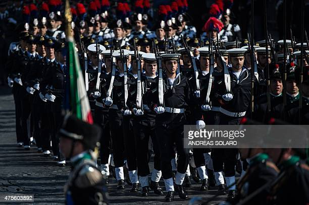 Italian soldiers march on Piazza Venezia near at the Vittoriano Unknown Soldier Monument in central Rome on June 2 during celebrations marking...