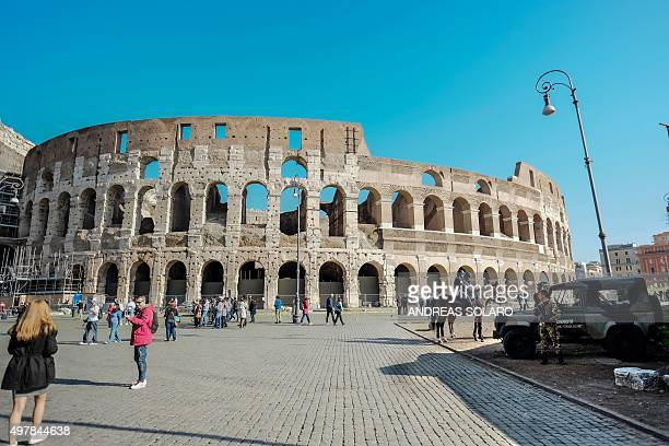 Italian soldiers stand in front of the colosseum and policemen patrol on horseback on November 19 2015 in Rome Italy has increased security at its...